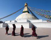 Nepal, Kathmandu -17th of December 2013: Tibetan Buddhist monks walking around Boudhanath stupa during festival — Stock Photo