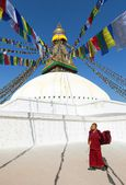 Nepal, Kathmandu -17th of December 2013: Tibetan Buddhist monks walking around Boudhanath stupa during festival — Stock Photo