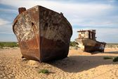 Boats in desert around Moynaq, Muynak or Moynoq - Aral sea or Aral lake - Uzbekistan - asia — Stock Photo