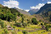 Beautiful village in western Nepal with mount Dhaulagiri — Stock Photo