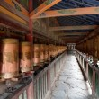 Prayer wheels in Labrang monastery - Buddhist monastery in Gansu province, China — Stock Photo