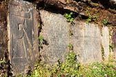 Pared mani y piedras con símbolos budistas — Foto de Stock