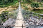 Rope hanging suspension bridge in Nepal — Stock Photo