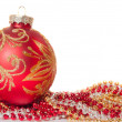 Red Christmas ball and beads — Stock Photo