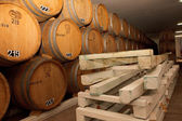 Wine cellar, barrels, aging, wine, winemaker, wood, tasting — Stock Photo