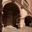 Verona, northern Italy, Ancient Street, the perspective of university walls and arch — Stock Photo #48130727