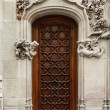 Spain, Barselona, wooden door of an old building with luxurious décor — Stock Photo