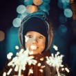 Stock Photo: Portrait of cute little boy holding sparklers