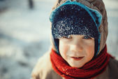 Portrait of a cute little boy in the snowy winter — Stock Photo