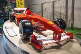 Ferrari formula one car on the podium — Stock Photo