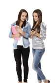 Happy teenagers looking at a smartphone — Stock Photo