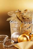 Christmas present with christmas balls — Stock Photo