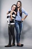 Teenager hugging her sister — Stock Photo