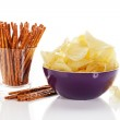 Potato chips in a bowl with pretzel sticks in a glass — Stock Photo #20009895