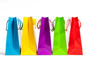 Four shopping bags in a row — Stock Photo