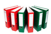 Half circle of red and green ring binders — Stock Photo