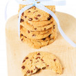 Stock Photo: Bitten cookie with stacked cookies with blue bow