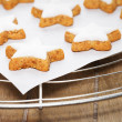 Cinnamon stars on a parchment paper on a cooling grid — Stock Photo