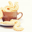 Stock Photo: Spritz cookies for christmas in a coffee cup