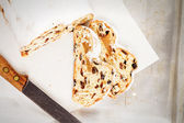 Traditional stollen cake from top on a parchment on a tray — Stock Photo