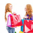 Two chatting redhead women with shopping bags — Stock Photo