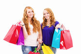 Two happy redhead women with shopping bags — Stock Photo