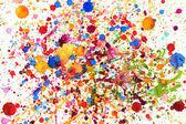 Spruzzi di colore vivido colorato di acqua — Foto Stock