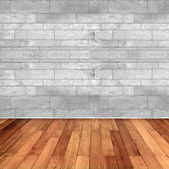 Empty room with wooden floor and white marble wall — Stock Photo