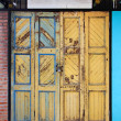 Royalty-Free Stock Photo: Yellow grunge wooden door background