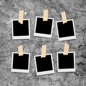 Sticky tape on paper photo frame isolated on grunge cement wall — Stock Photo