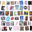 English alphabet cut from magazine isolated on white background — Stock Photo