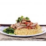 Chinese roast pork noodle dish isolated on white background — Stock Photo #27461389