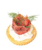 Smoked pepper salmon cream cheese on cracker — Stock Photo