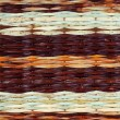 Colorful woven wicker background — Stock Photo