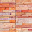 Orange rock brick wall texture background — Stock Photo