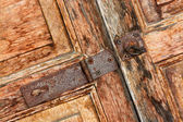 Locked wooden door with key chain background — Stock Photo