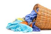 Full wicker laundry basket  isolated on white background — Stock Photo