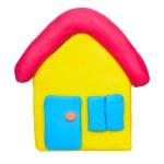 Plasticine clay house on white background — Stock Photo #50528335