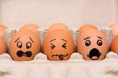 Panic face eggs in brown paper box — Stock Photo