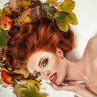 Beauty portrait with autumn leaves — Stock fotografie