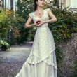 Stock Photo: Womin beautiful long white dress