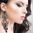 Young woman beauty portrait with earrings — Stock Photo
