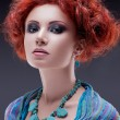 Stock Photo: Redhead woman with turquoise necklace