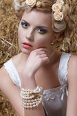 Woman with hairstyle and golden garnish in hair — Stock Photo