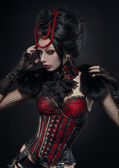 Brunette woman in gothic outfit — Stock fotografie