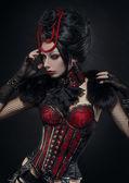 Brünette frau im gothic outfit — Stockfoto