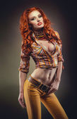 Fashion shot of sexy redhead woman in stylish outfit — Stok fotoğraf