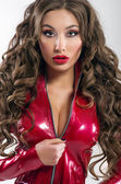 Sexy woman in red latex costume — Stok fotoğraf