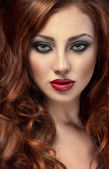 Beautiful woman with posh red hair — Stockfoto