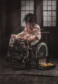 Paciente doente em cadeira de rodas — Fotografia Stock